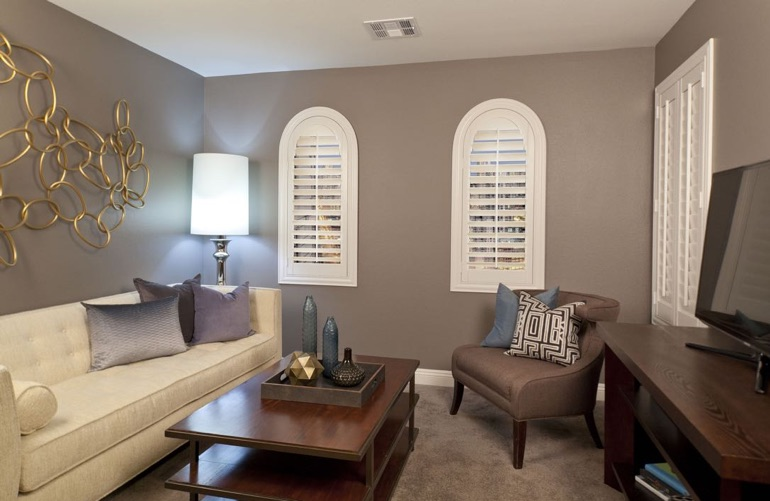 San Diego family room with arch plantation shutters.