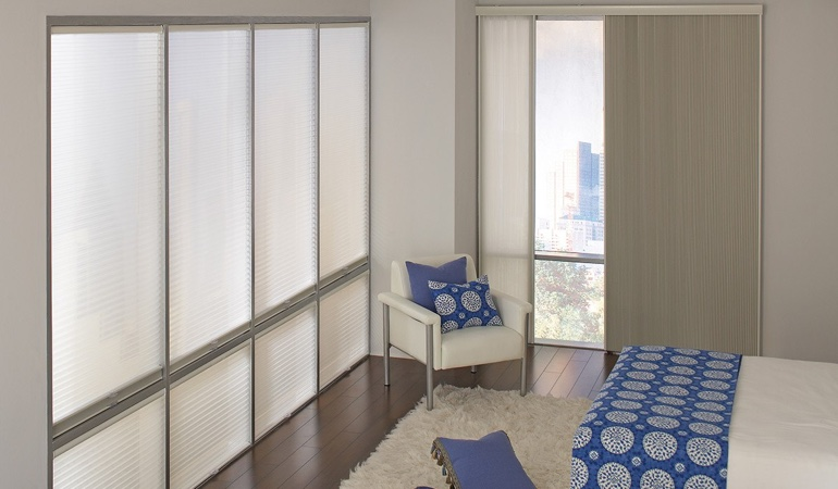 Cellular shades in a modern bedroom.
