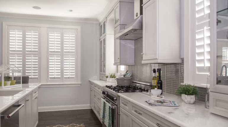 Plantation shutters in San Diego kitchen with marble counter.