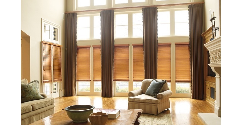 San Diego great room with wooden blinds and full-length draperies.