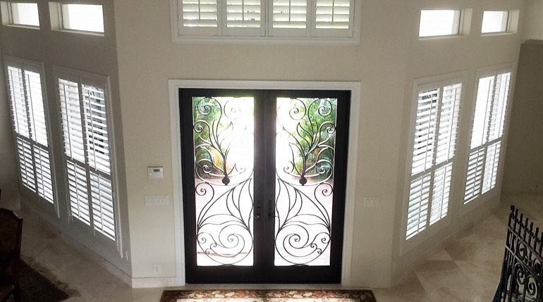 San Diego foyer with glass doors and plantation shutters
