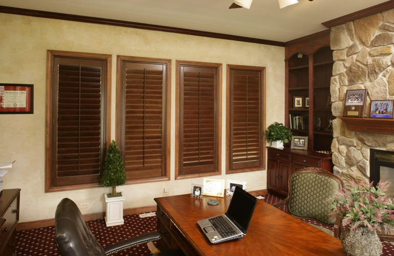 Hardwood plantation shutters in a San Diego home office