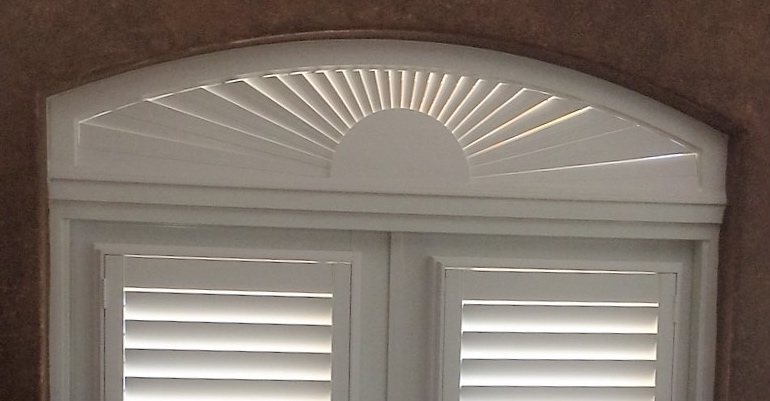 Eyebrow window above door with shutters