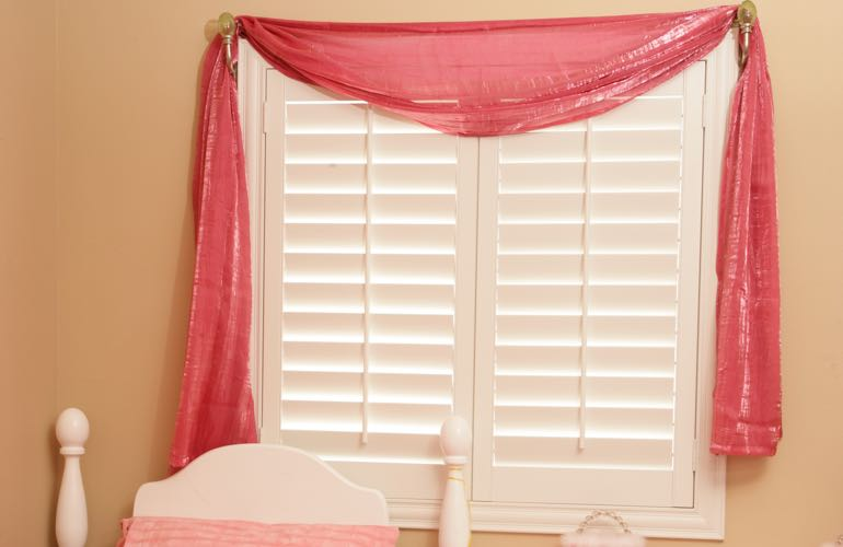 Child's bedroom with white shutters.