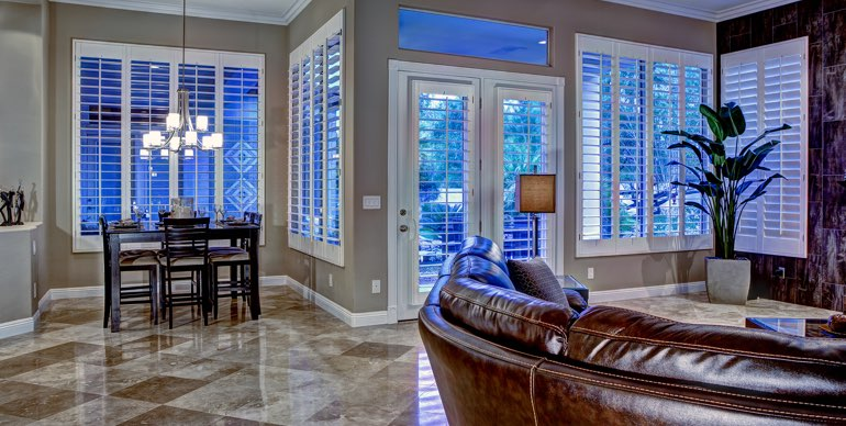 San Diego great room with plantation shutters and tile floor.