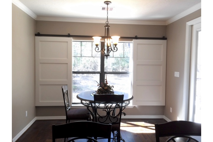 San Diego dining room with moveable barn door shutters.