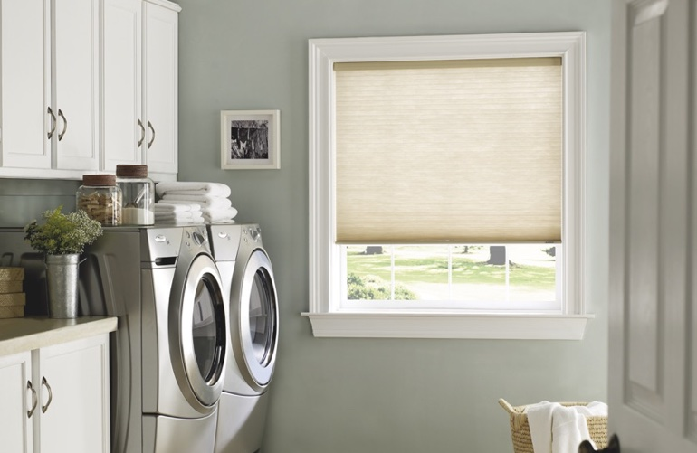 San Diego laundry room with beige window shades.