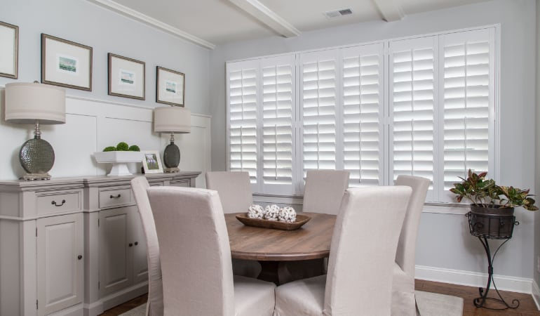 Plantation shutters in a San Diego dining room.