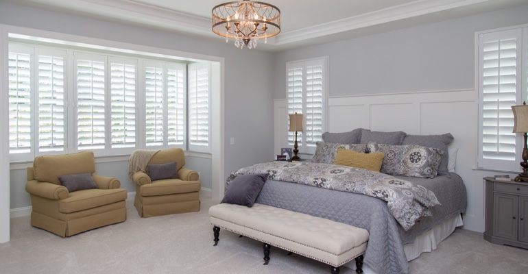 Plantation shutters in San Diego bedroom.