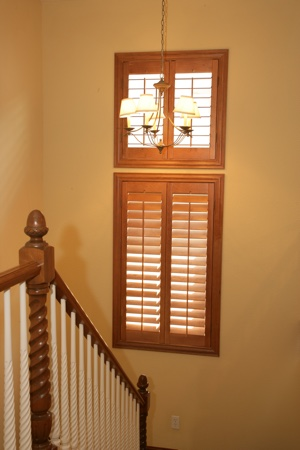 Ovation plantation shutters in tan stairwell.