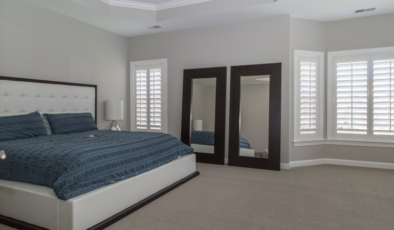 White shutters in a minimalist bedroom in San Diego.