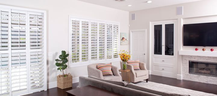 San Diego living room in white with plantation shutters.