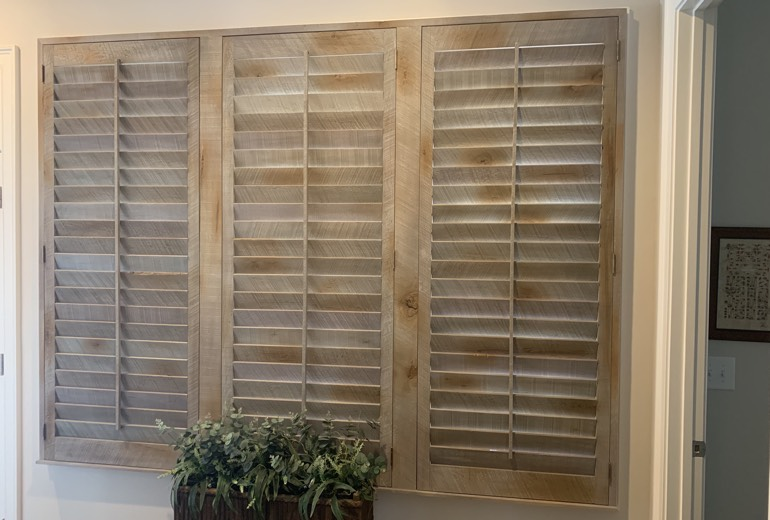 Closed reclaimed wood shutters in San Diego