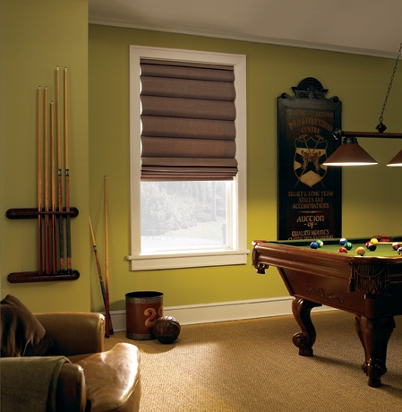 Roman shades in San Diego game room with green walls.