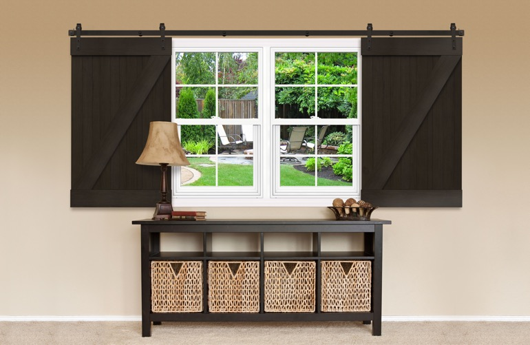 Dark brown sliding barn doors on a window