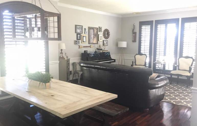 Natural Wood shutters in family room windows by Sunburst Shutters San Diego.