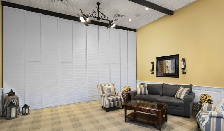 Shutters as a room divider for a showroom