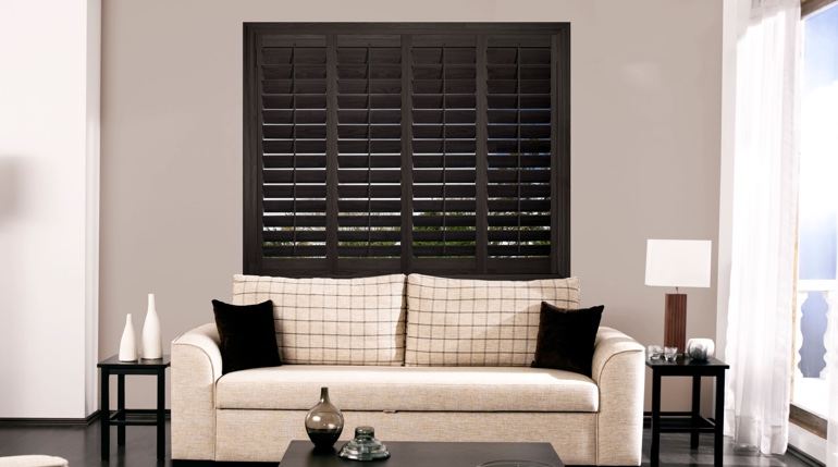 San Diego sitting room with black shutters.