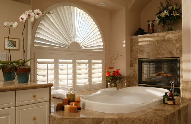 Semicircle shutters in a San Diego bathroom.