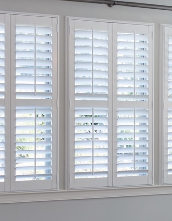 Hidden tilt rod shutters on San Diego windows