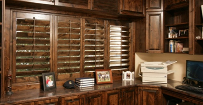 Wood shutters in home office.