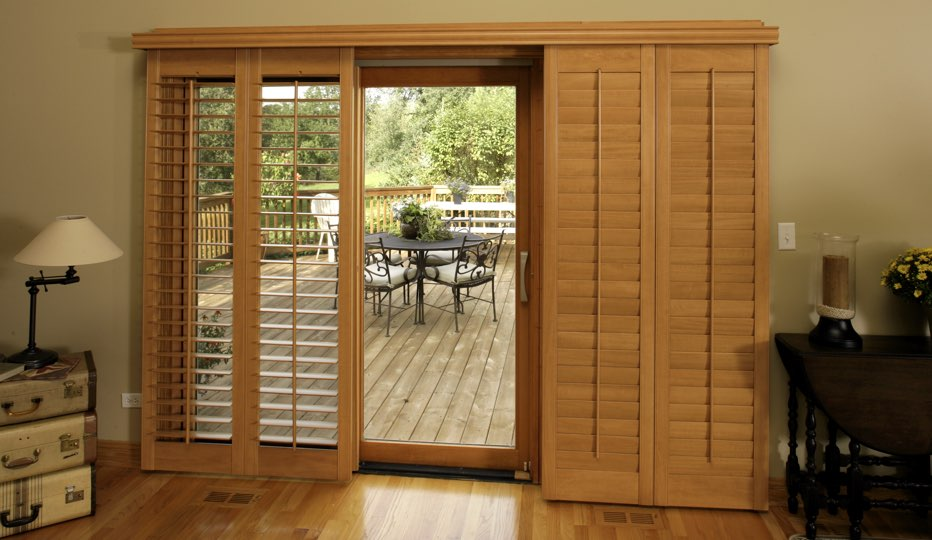 Bypass wood patio door shutters in San Diego living room