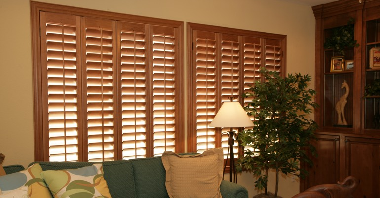 Hardwood shutters in San Diego living room.