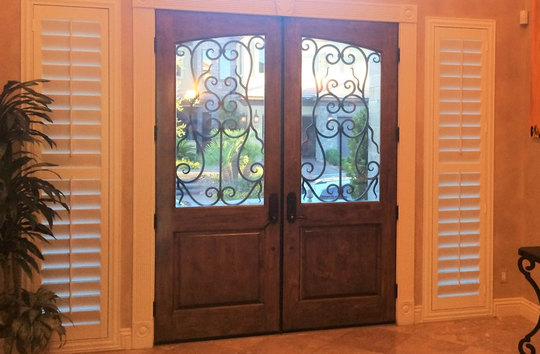 Sidelight window shutters in San Diego foyer