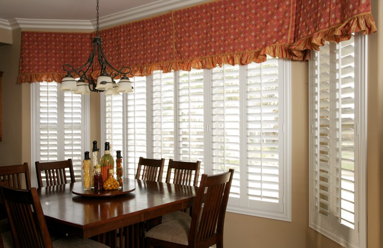 Shutters on wide kitchen windows